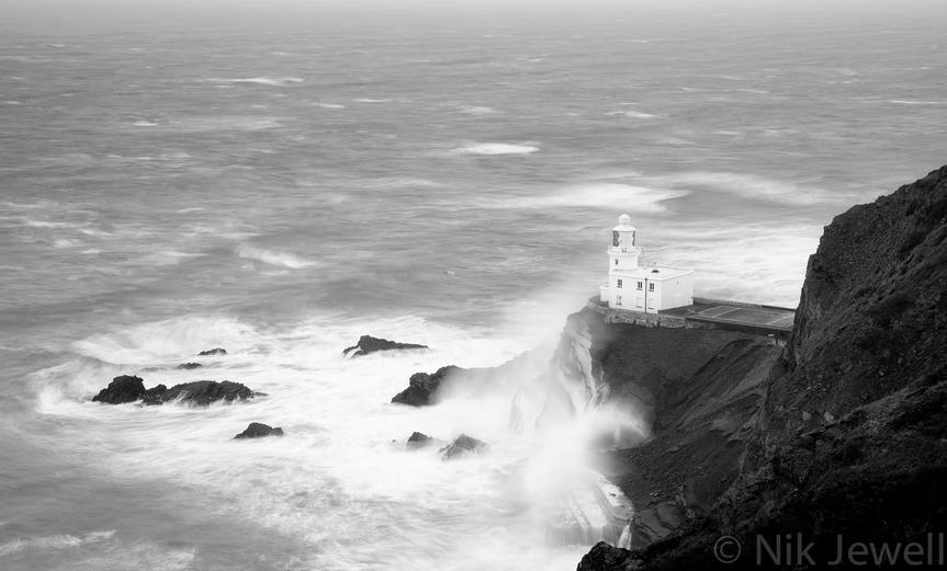 The approaching Hercules Storm creates a maelstrom like effect in the seas below the Hartland Point lighthouse in North Devon.
