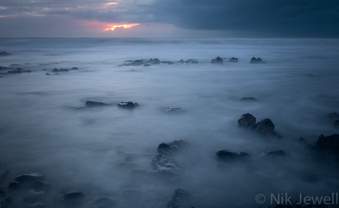 Alien landscape created after sunset with the use of 10 stop B+W filter at Sandymouth near Bude in North Cornwall.