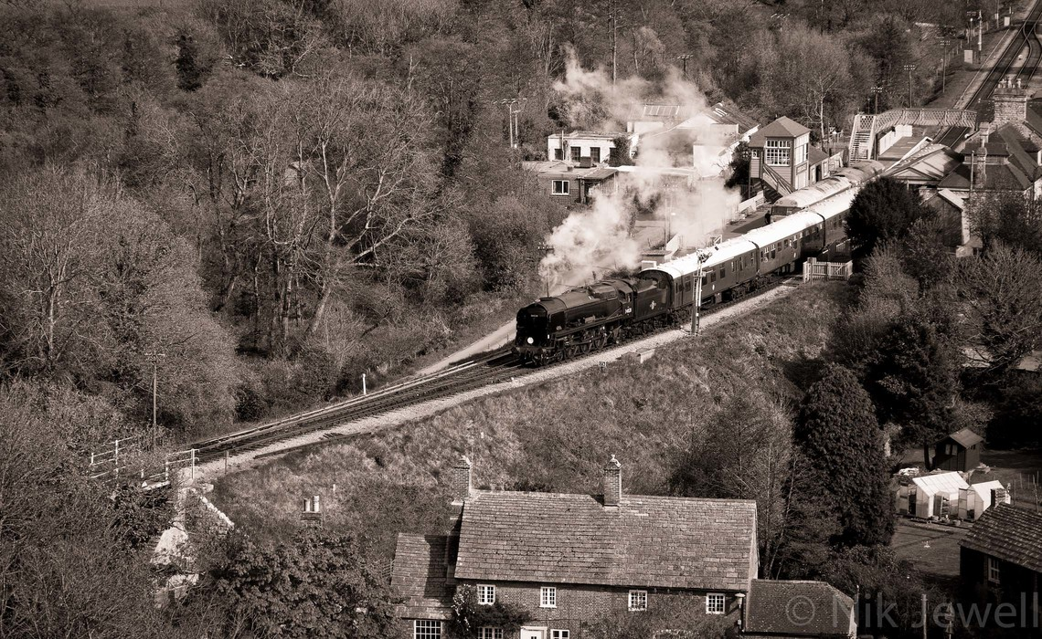 The steam train 34208 'Eddystone' below Corfe Castle on the Swanage Railway in Purbeck in Dorset