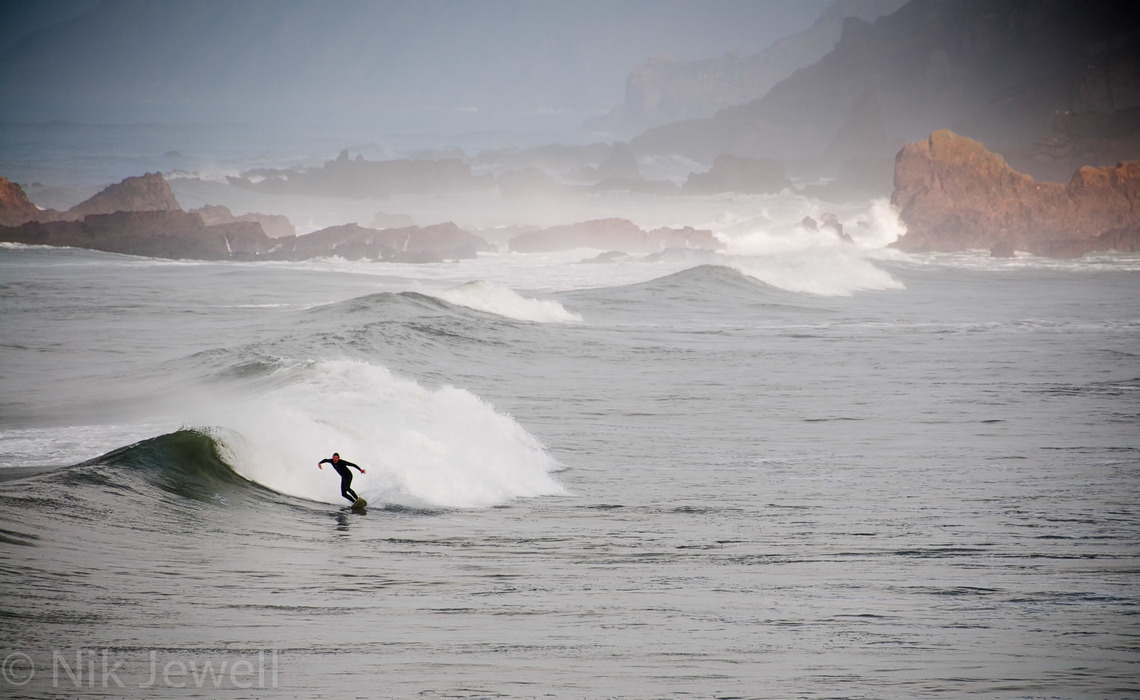 Image of a surfer in the sea off Summerleaze Beach at Bude