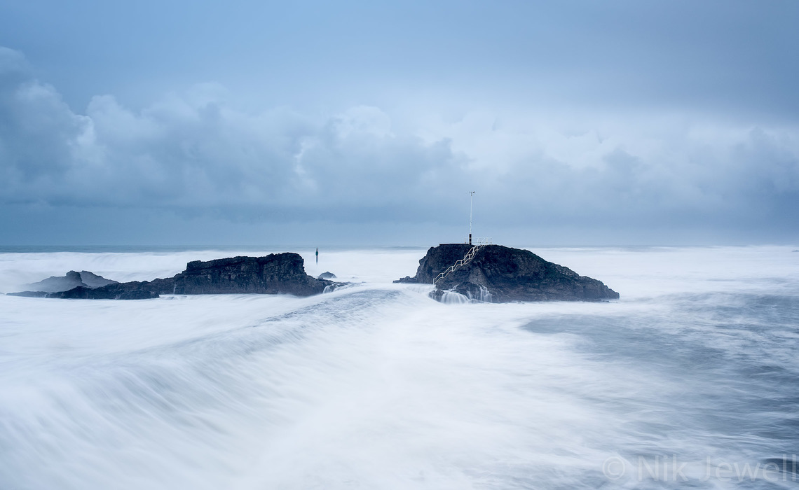 Image showing water rushing over the breakwater at Bude during the January storm surge