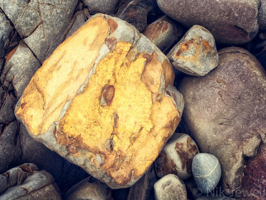 Image of a golden coloured rock at Northcott Mouth