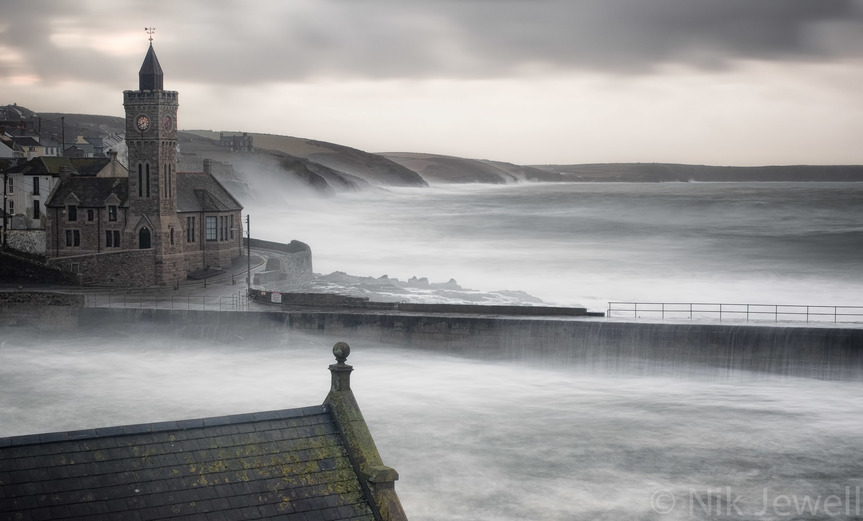Long exposure image of water coming over the harbour wall at Porthleven