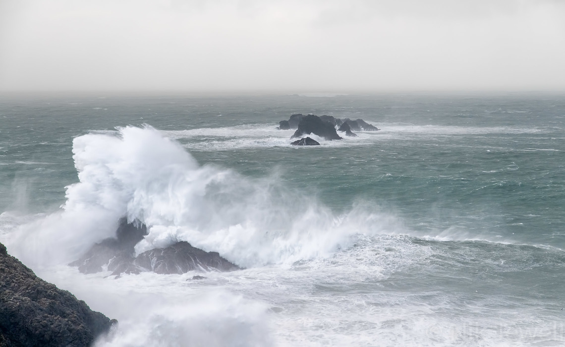 Image of wave breaking on Bull Rock at Dinas Head