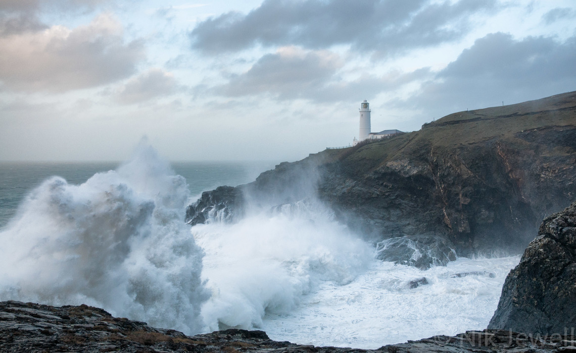 Image of huge wave and lighthouse at Trevose Head
