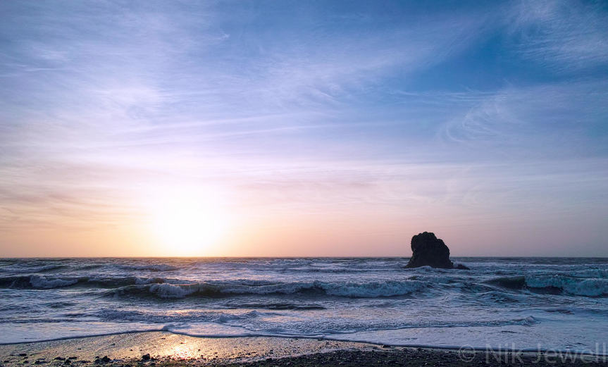 Sunset and the Black Rock at Black Rock Beach, Widemouth Bay near Bude in North Cornwall