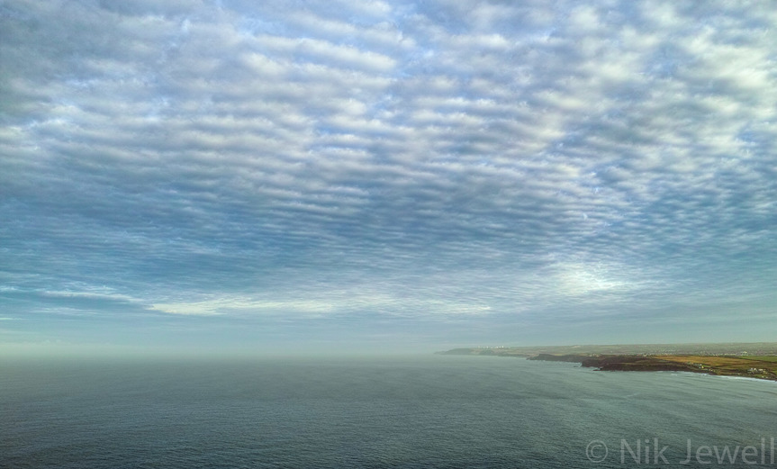 Mackerel sky of altocumulus clouds photographed at dawn from Penhalt Cliff between Widemouth Bay and Millook Haven near Bude in North Cornwall