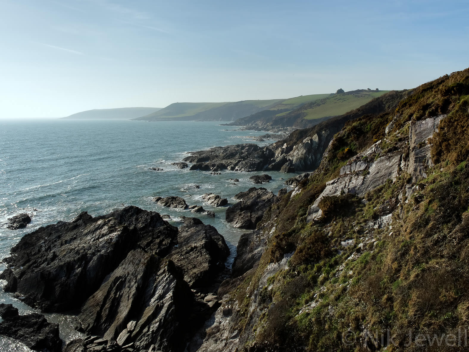 St Anchorite's Rock from above Butcher's Cove on the South West Coast Path in the South Hams, Devon
