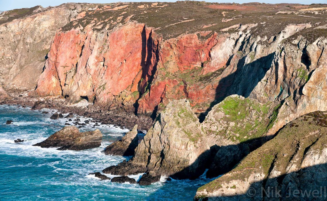 The colourful cliffs of mixed granites and killas at Cligga Head between Perranporth and St Agnes in Cornwall